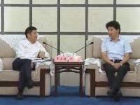 何录春会见中国能源建设集团规划设计有限公司董事长罗必雄